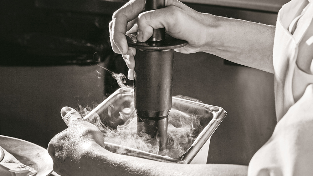 Preparing foie gras at WD~50