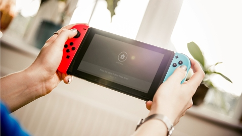 People Playing A Nintendo Switch