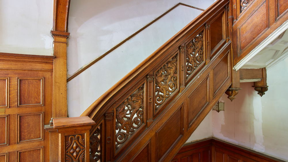 A closer look at the wooden staircase's detailing.