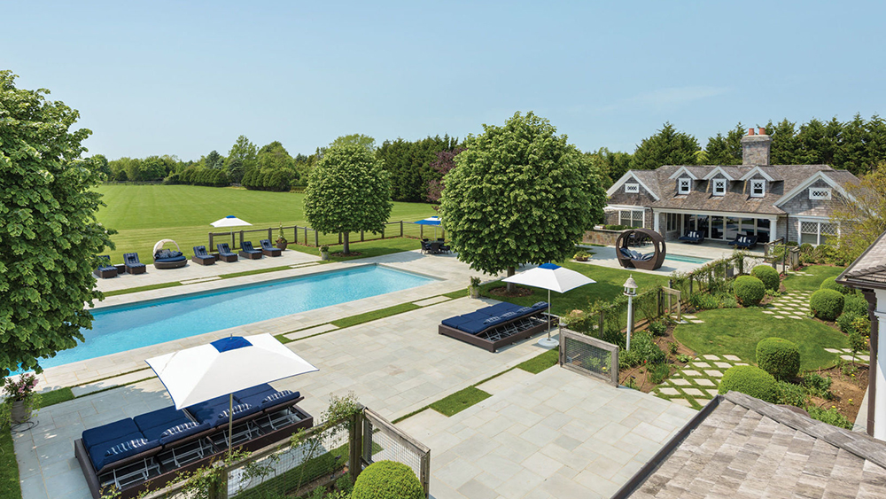 The pool and patio at The Sandcastle in Bridgehampton
