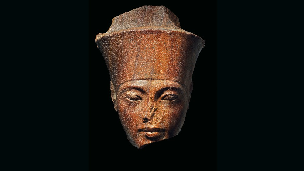 A brown quartzite statue with the features of King Tutankhamun