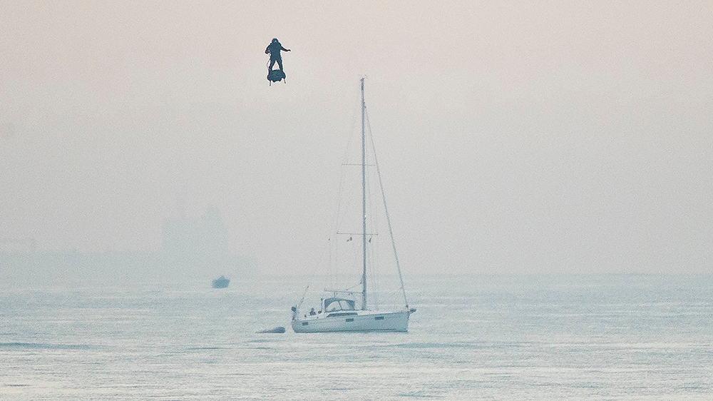 French inventor Franky Zapata passes near a sailing yacht as he heads to St Margarets Bay near Dover crossing the English Channel on his jet-powered hoverboard.Hoverboard Channel crossing attempt, Dover, UK - 04 Aug 2019French inventor Franky Zapata made the 35km crossing with a refueling stop mid channel to reach the English coast after setting off at 6:15am French time.