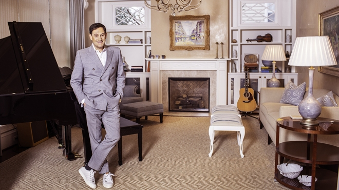 Entrepreneur and cofounder of bluemercury Barry Beck plays the guitar inside the music room of his home on January 17, 2019 in Bethesda, Maryland.