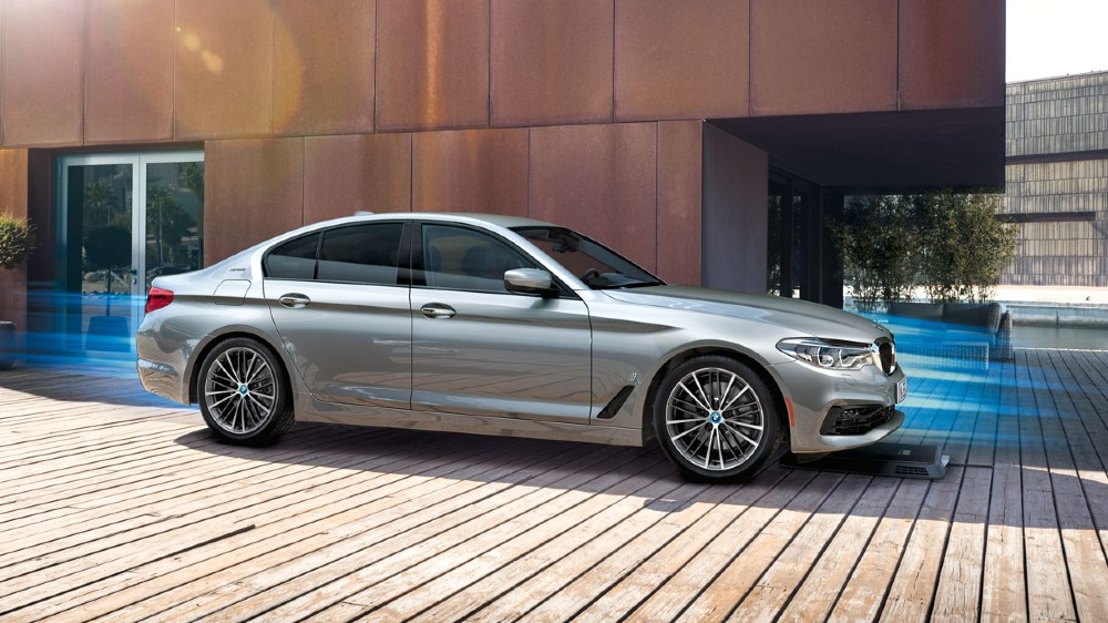 A 2019 BMW 530e plug-in hybrid and the automaker's wireless charging system