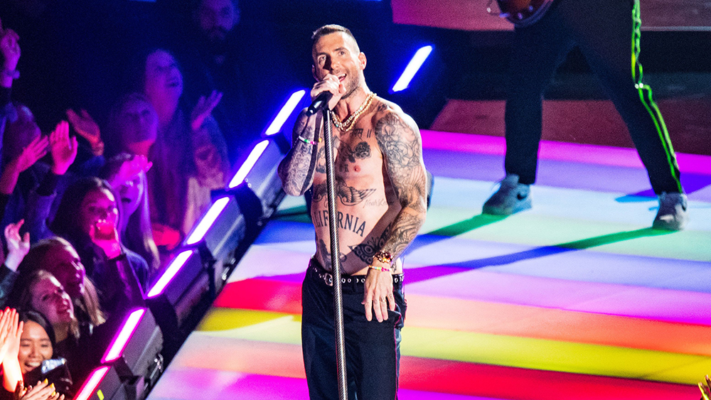 Adam Levine wears a Rolex's Rainbow Cosmograph Daytona during his Super Bowl LIII performance