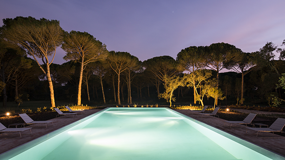 Outdoor pool by night at Sublime Comporta