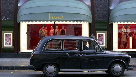 Taxi in front of a shop window of Harrods department store, London, England, Great Britain, EuropeVARIOUS