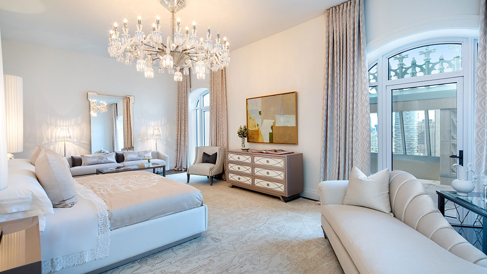 The master bedroom boasts a spectacular chandelier from Baccarat.