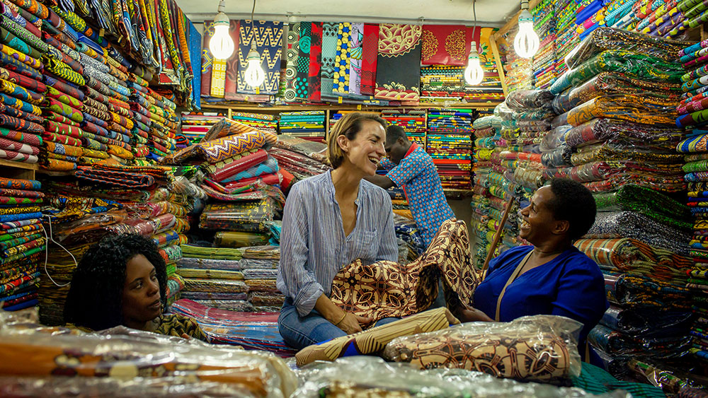 Crippen and Habasa scouring a textile market in Kampala.