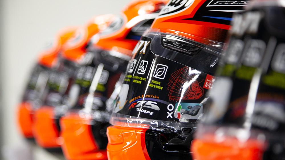 A row of Arai motorcycle helmets.