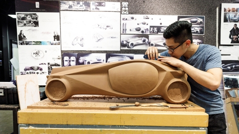 A student at ArtCenter College of Design fine-tunes his model.