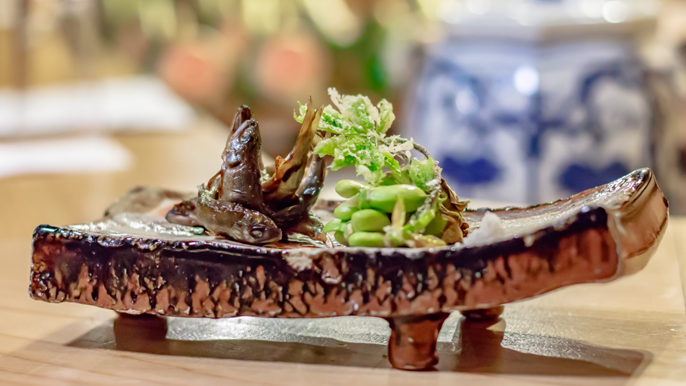 Young sweetfish grilled over charcoal with broad beans.