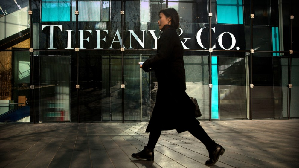 A woman walks past a Tiffany & Co. store at a shopping mall in Beijing