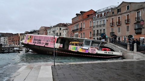 A fairy boat stranded because of flooding in Venice, Italy on November 13, 2019
