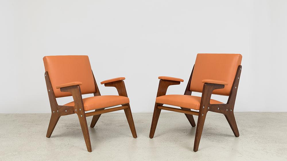 José Zanine Caldas Plywood and orange vinyl armchairs, 1950s