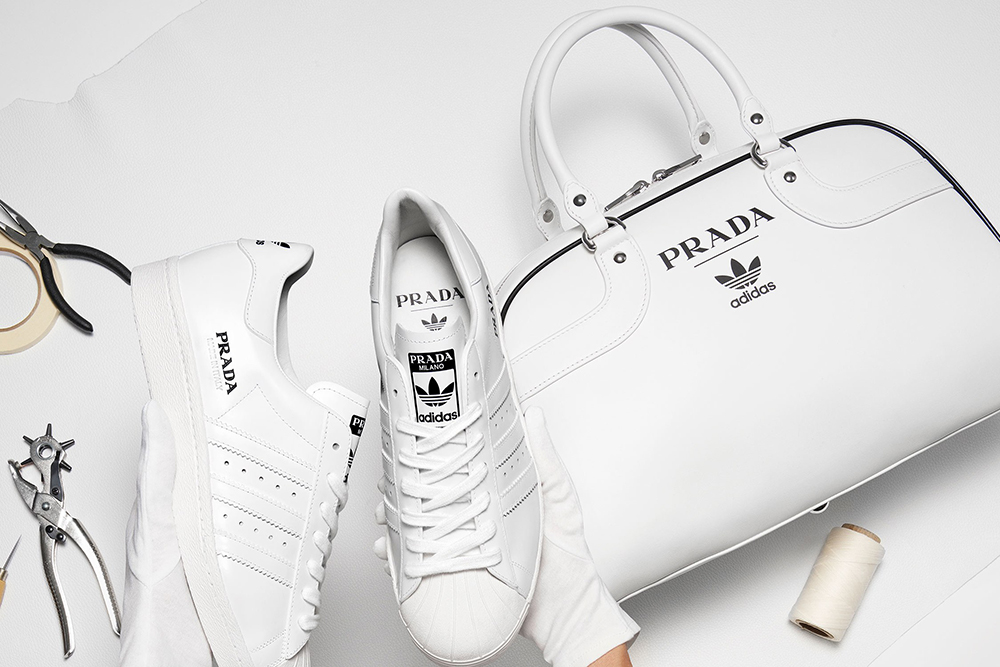 Prada and Adidas have finally unveiled their collaboration, which produced a pair of sneakers and a tote bag.