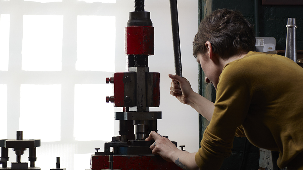 Rebecca Struthers making watch dials on a 19th-century jeweler's fly press