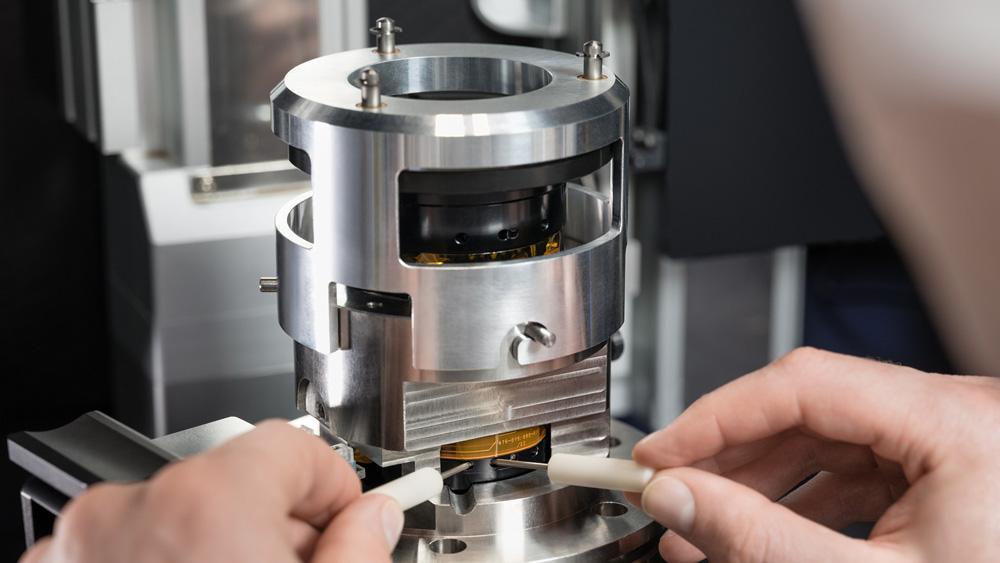 Making fine adjustments on the SL2's optical system.
