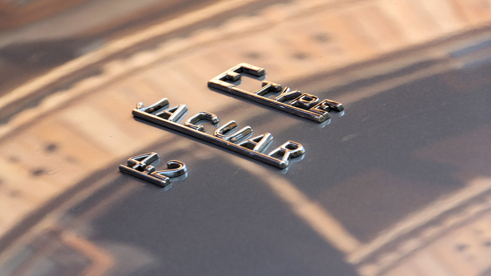 A Jaguar E-Type's distinctive badging.