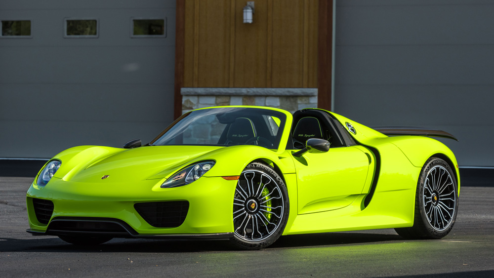 This 2015 Porsche 918 Spyder features a rare acid green paint scheme and an interior of black leather and suede.