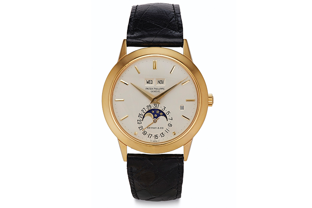 Patek Philippe. A Very Fine and Rare 18k Gold Automatic Perpetual Calendar Wristwatch with Moon Phases and Leap Year Indication