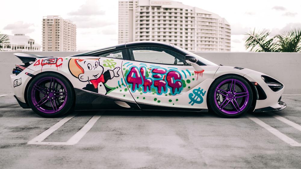 A McLaren 720S painted by graffiti artist Alec Monopoly.