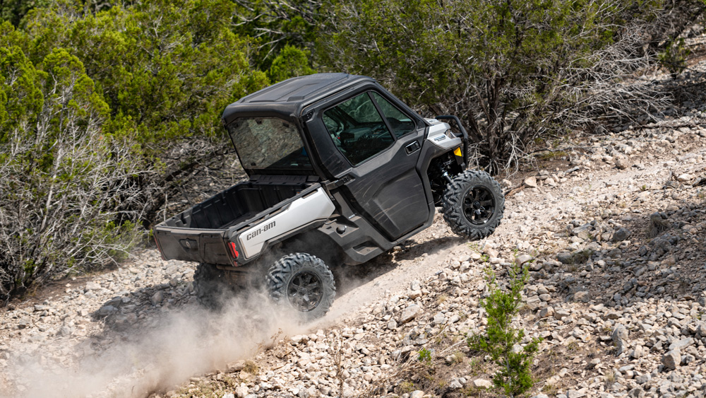 The Can-Am Defender Limited ascends a gravel incline.