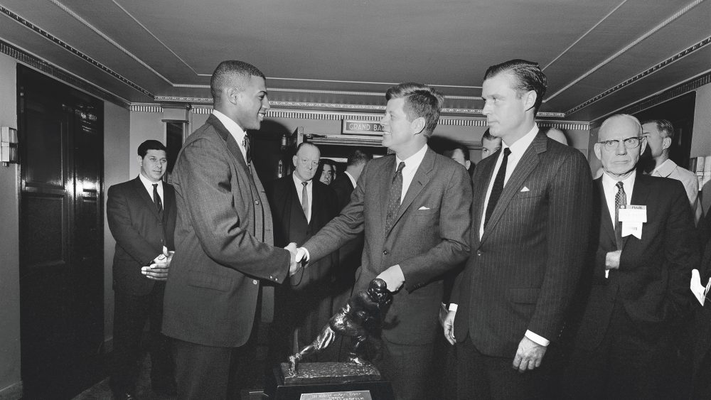 December 6, 1961: President Kennedy presents Ernie Davis the Heisman Trophy. 05 December, 1961President Kennedy greets 1961 Heisman Trophy winner Ernie Davis at a reception sponsored by the National Association of Manufacturers, Waldorf-Astoria Hotel, New York City, 12:07PMPlease Credit Cecil Stoughton. White House Photographs. John F. Kennedy Presidential Library and Museum, Boston