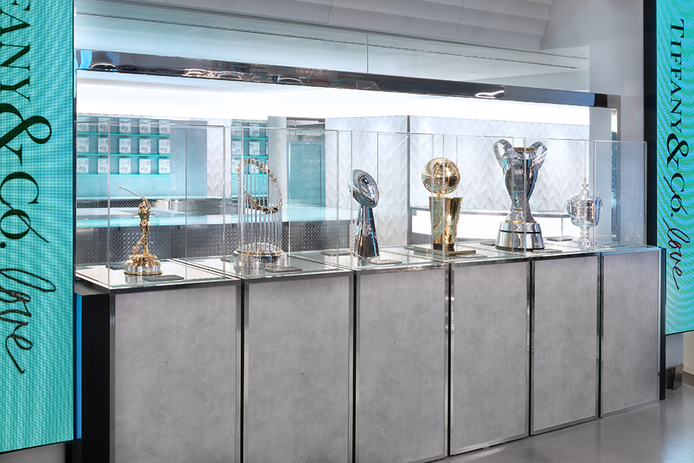 NFL, NBA, MLS and other league championship trophies on display at Tiffany & Co's new men's flagship store in New York City.