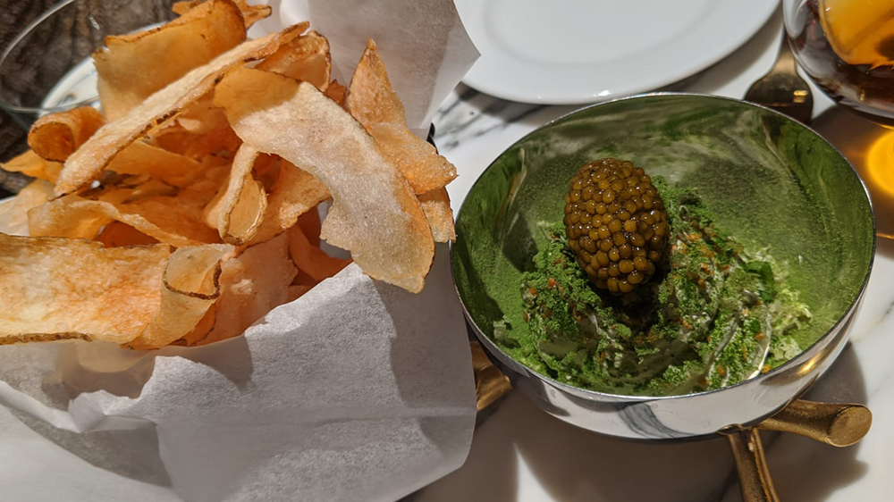 Caviar, crème fraîche and potato chips at Goodman's Bar