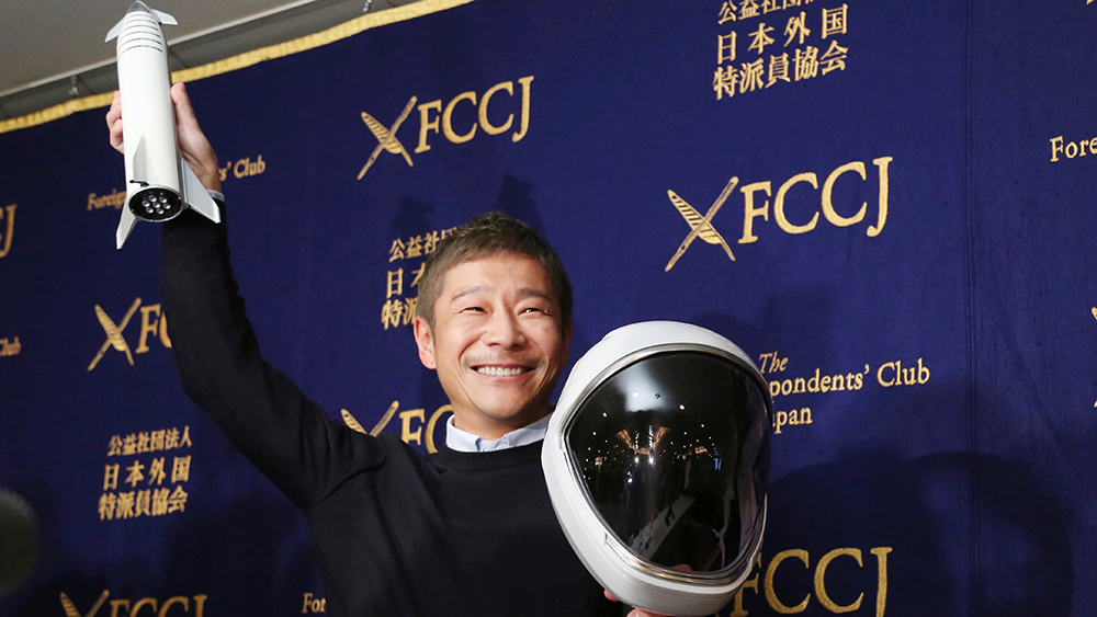 Zozo Chief Executive Yusaku Maezawa poses for the media prior to his news conference in Tokyo, . The Japanese online retail tycoon who plans to travel to the moon on the SpaceX rocket says he respects and trusts Elon Musk as a fellow entrepreneur, despite his recent troublesSpace X Billionaire