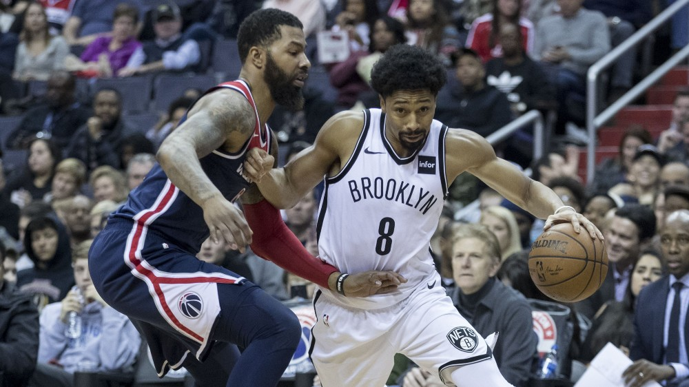 Spencer Dinwiddie (right) dribbles past then-Washington Wizards player Markieff Morris in 2018