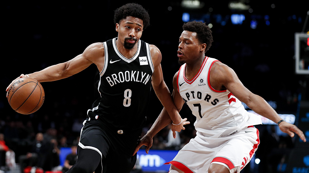 The Brooklyn Nets' Spencer Dinwiddie and the Toronto Raptors' Kyle Lowry