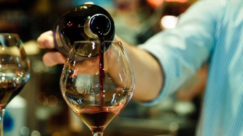 pouring wine at a bar