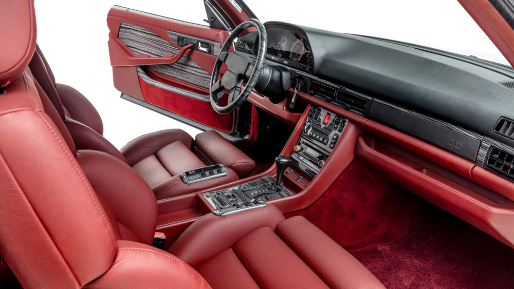 The interior of a restomod 1989 Widebody Mercedes 560 SEC Coupe.