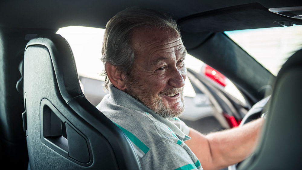 Valentino Balboni, former Lamborghini test driver, behind the wheel of the all-electric Drako GTE supercar.