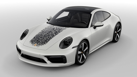 A Porsche 911 with a customer's giant fingerprint painted on the hood.