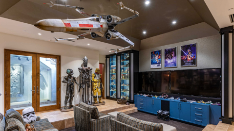 The X-wing replica, with a miniature Luke Skywalker, R2D2 and C3PO flying it.
