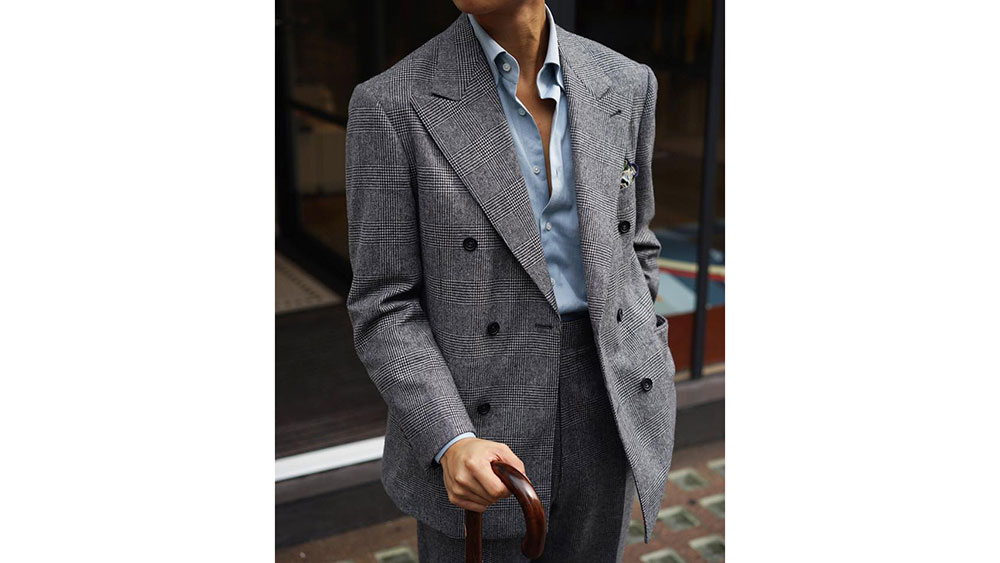 A double-breasted herringbone suit by The Anthology.