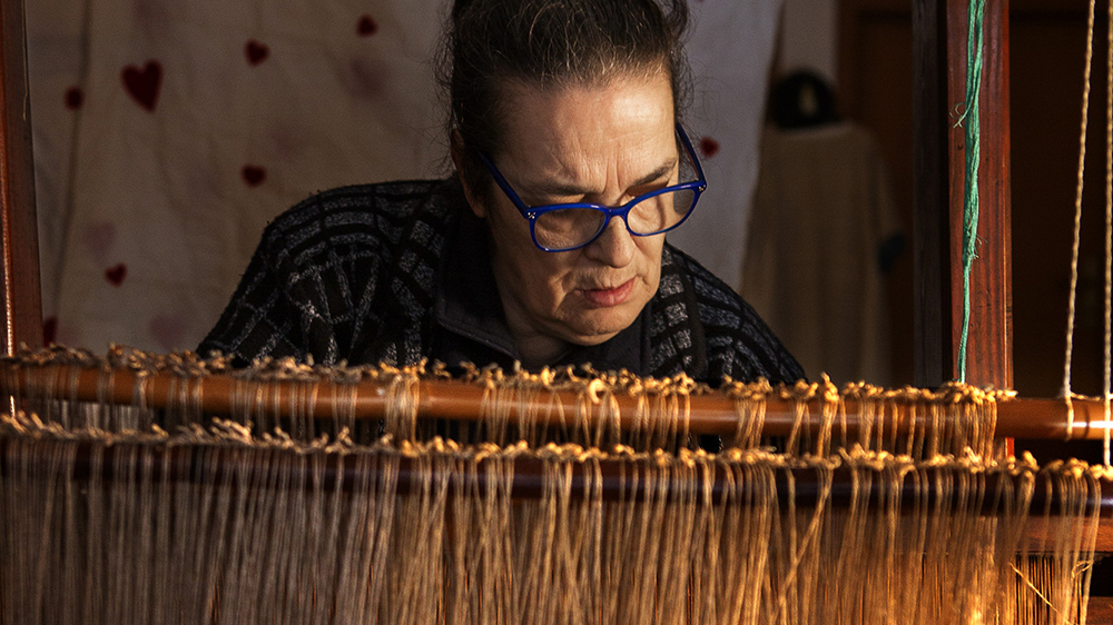 Vigo at her loom on the Italian island of Sant'Antioco