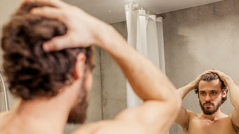 beautiful young muscular guy in bathroom at morning. handsome caucasian half-naked man after shower. hygiene, people concept; Shutterstock ID 1660221193; Notes: RR digital