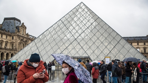 Visitors wait to get into the Louvre on Monday, March 2, 2020