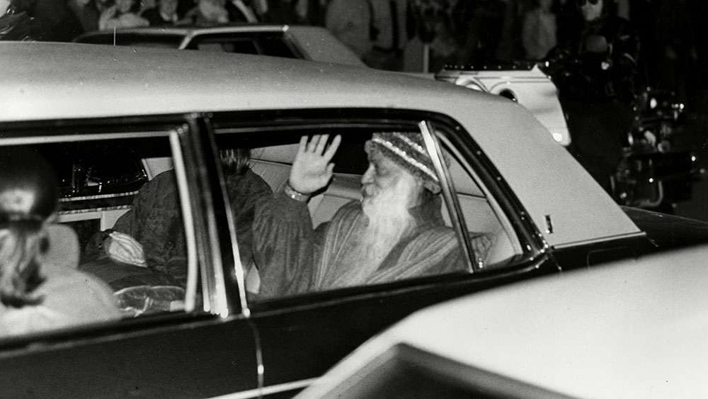 Rajneesh Indian guru Bhagwan Shree Rajneesh waves to the crowd from the backseat of his Rolls-Royce limousine after plea bargaining in Portland, Ore., federal court on two federal immigration charges, . Rajneesh changed his plea to guilty, received a 10-year suspended prison sentence, was fined $400,000 and agreed to leave the countryU.S. DEPORTATION RAJNEESH, PORTLAND, USA
