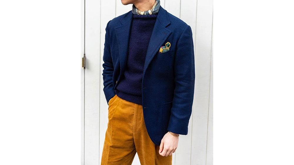 A notch-lapel navy blue blazer by The Anthology.