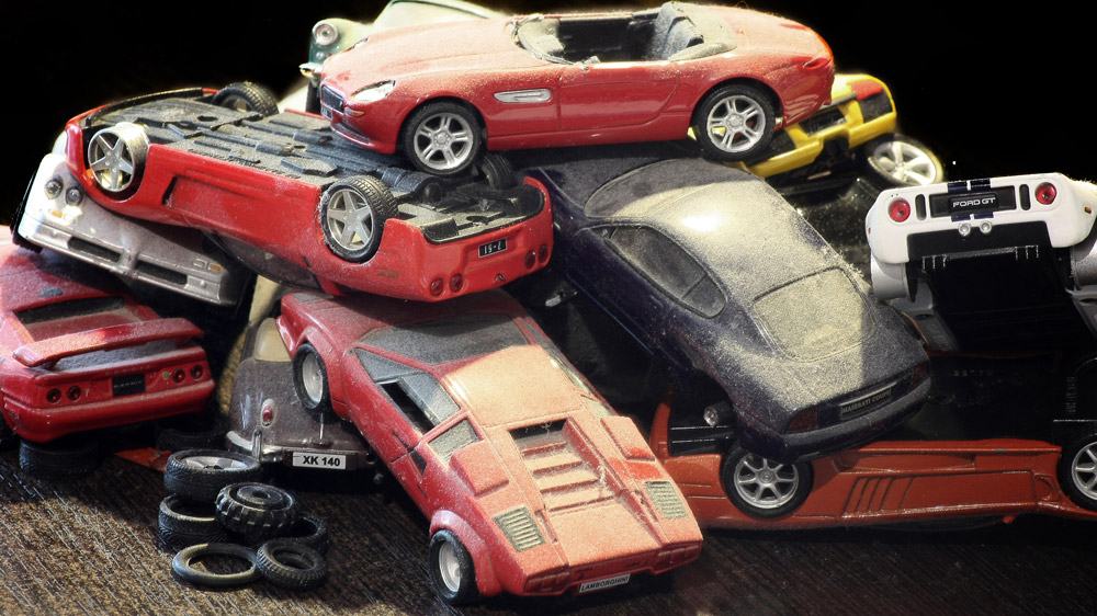 A dusty pile of toy supercars.