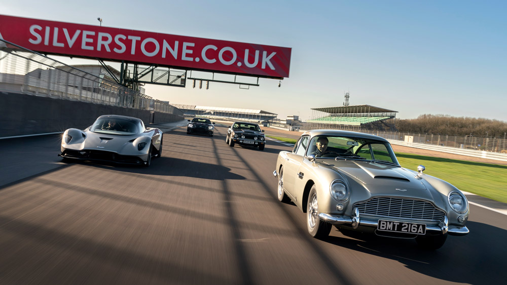 """The Aston Martin Models in Bond Film """"No Time to Die"""" at Silverstone Circuit."""
