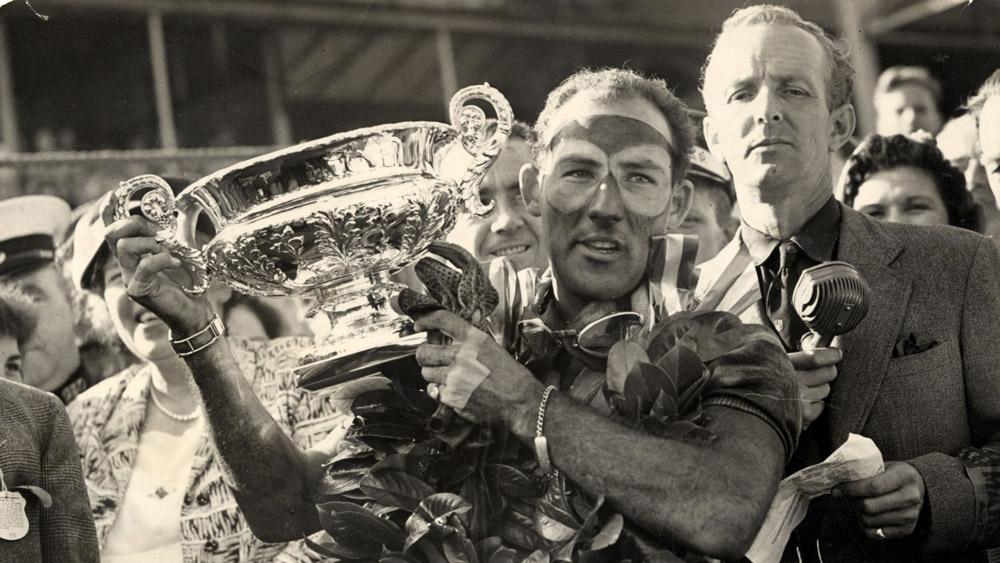 Stirling Moss winning the first British Grand Prix in 1955.