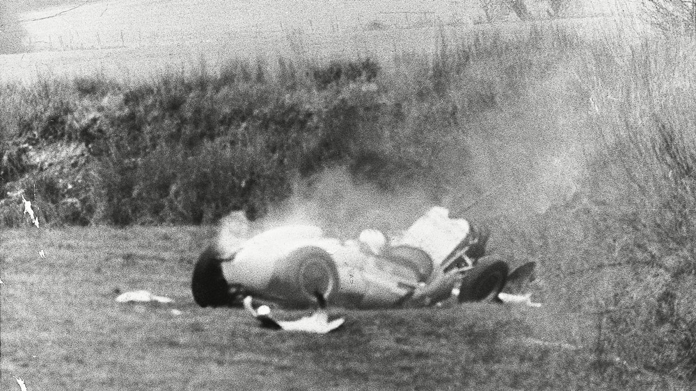 Stirling Moss trapped in his car after accident at Goodwood in 1962.