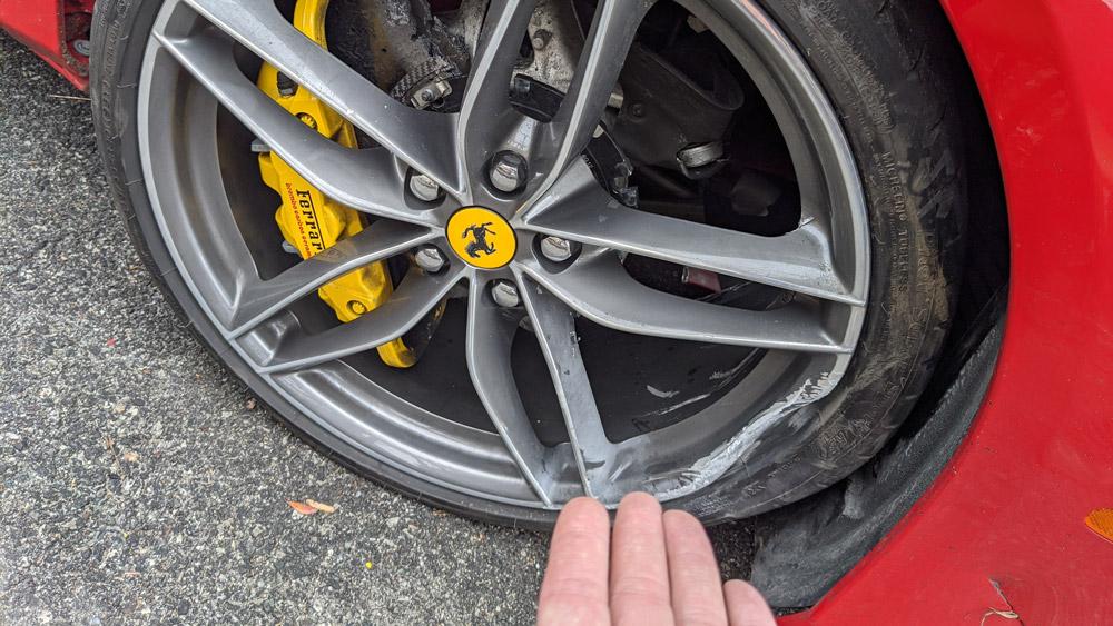 A damaged Ferrari wheel.
