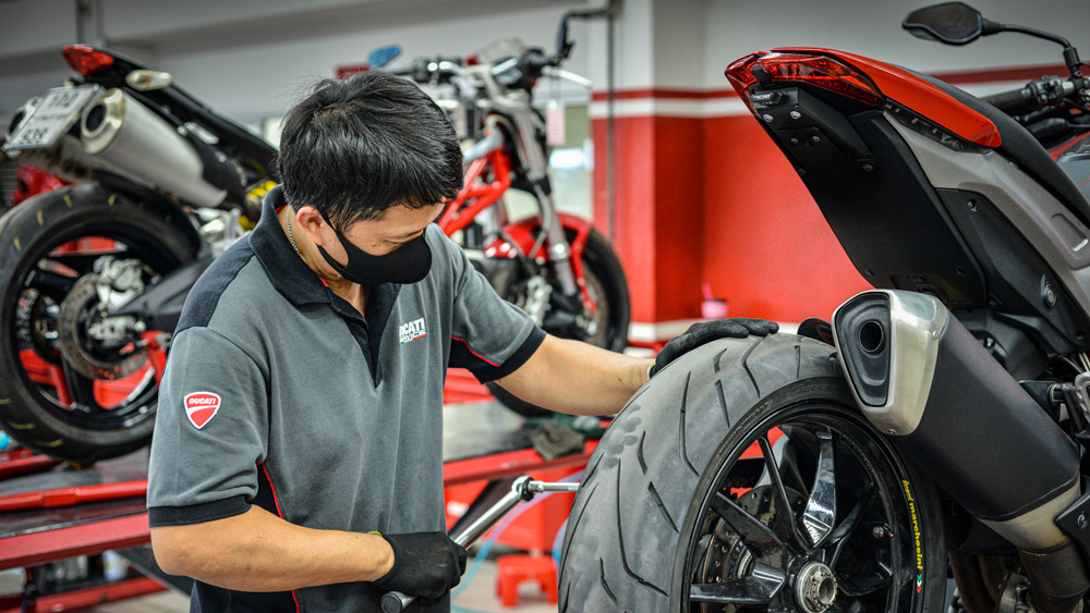 A Ducati employee wearing a face mask.